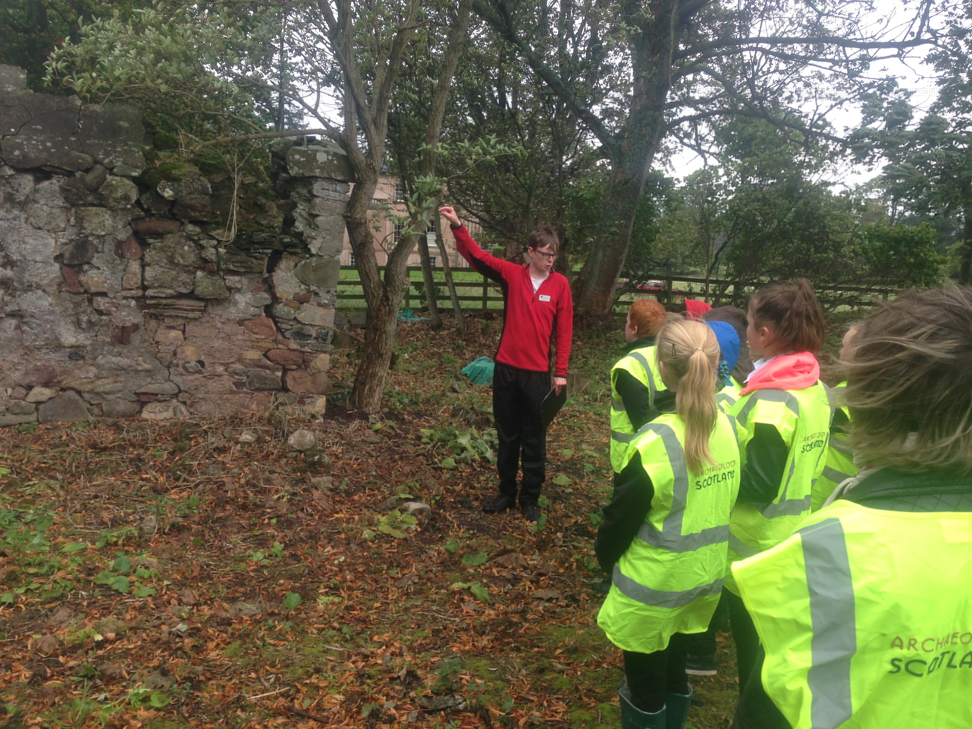 Project Officer Martin Conlon guides the pupils through the remains of the church.
